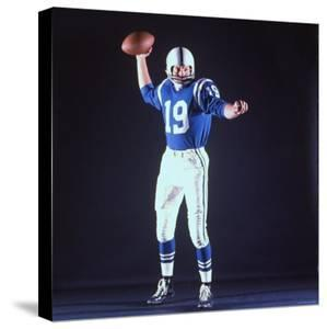 Baltimore Colts Football Player Johnny Unitas in Uniform While Holding Ball in Passing Stance by Yale Joel