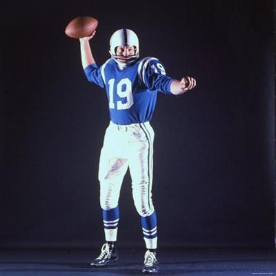 Baltimore Colts Football Player Johnny Unitas in Uniform While Holding Ball in Passing Stance