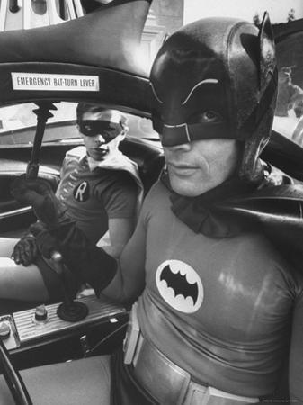 "Batman Adam West and ""Robin"" Burt Ward in Bat Mobile, on Set During Shooting of Scene"