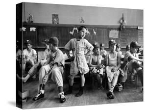 Boys Club Little League Baseball Players Putting on Their Uniforms Prior to Playing Game by Yale Joel