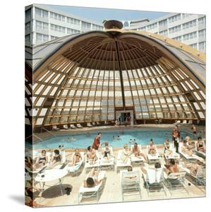 Dome over Swimming Pool as Guests are Served Cocktails at International Inn, Washington DC, 1963 by Yale Joel
