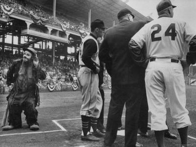 Emmet Kelly at Dodgers Game as Pirates Player Dick Groat and Dodger Manager Walter Alston confer