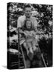 Father and Daughter Playing on Slide During Father's Day at Co-Op Nursery School Owned by Parents by Yale Joel