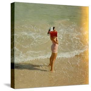 Female Tourist Enjoying Surf on a Florida Beach by Yale Joel