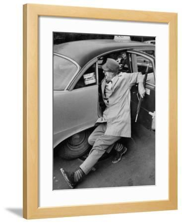 French Actor Jacques Tati Comically Getting Out of a Cab