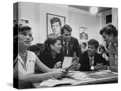 John F. Kennedy with Brother and Sisters Working on His Senate Campaign