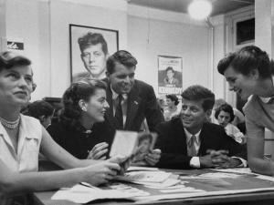 John F. Kennedy with Brother and Sisters Working on His Senate Campaign by Yale Joel