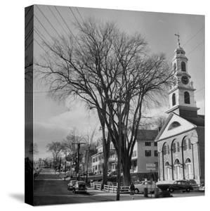 Main Street in Small New England Town, Showing Church, Stores, Etc by Yale Joel