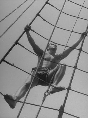 Man Climbing Ropes on Board Sailing Ship Yankee