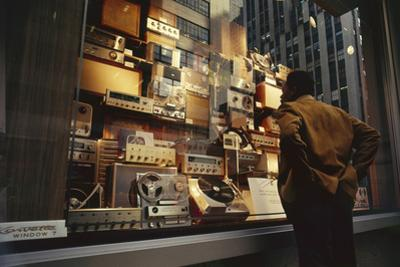 Man Looks at a Window Display of an Electronics Store, New York, New York, 1963