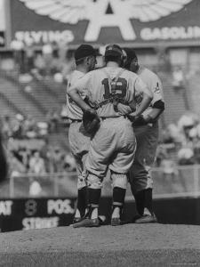 Members of the Cleveland Indians Conferring on the Mound During a Game by Yale Joel