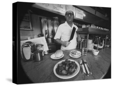 Owner-Chef Lowell Knapp, the Owner of the S&C Diner, Posing for the Camera