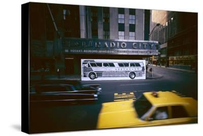 Poster of a Greyhound Bus in Front of Radio City Music Hall, New York, New York, Summer 1967
