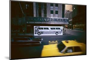 Poster of a Greyhound Bus in Front of Radio City Music Hall, New York, New York, Summer 1967 by Yale Joel