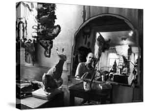 Reflected Portrait of Artist Claes Oldenburg, Sitting in Dirty, Studio Apartment by Yale Joel