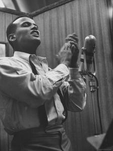 Singer Harry Belafonte Performing at a Recording Session by Yale Joel