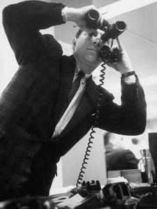 Stock Market Salesman with Binoculars by Yale Joel