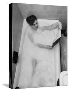 Student Vera Bogach of Massachusetts College, Studying for Exams in a Bubble Bath by Yale Joel