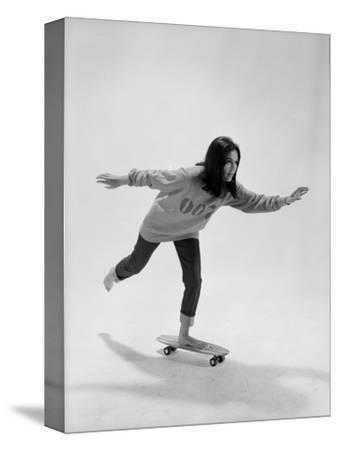 Studio Photos of Gloria Steinem Riding a Skateboard with a 007 James Bond Sweatshirt, 1965