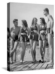 Swiss Youths Standing on the Boardwalk at the Beach by Yale Joel