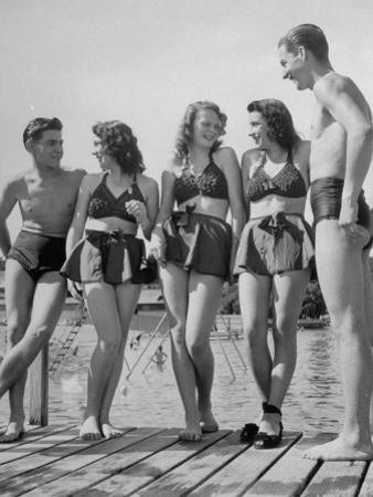 Swiss Youths Standing on the Boardwalk at the Beach