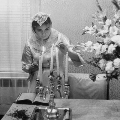 Woman Lighting Candles During Hasidic Jewish Wedding Ceremony