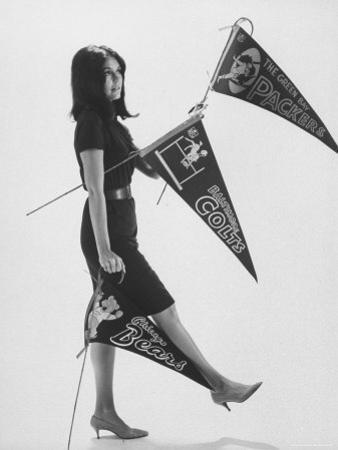 Writer Gloria Steinem Carrying Banners for Professional Football Teams