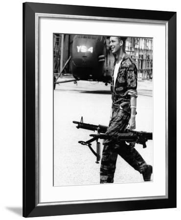 Yankee Papa 13 Helicopter Crew Chief James Farley Carrying a Pair of M-60 Machine Guns-Larry Burrows-Framed Photographic Print