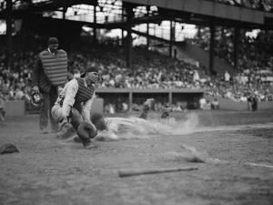 Yankees Lou Gehrig Scores as Joe Harris' Throw Gets Away from Catcher Hank Severeid of Senators