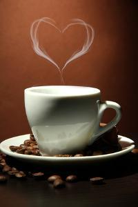 Cup Of Coffee With Smoke In Shape Of Heart On Brown Background by Yastremska