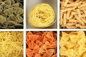 Different Types Of Pasta In White Wooden Box Sections Close-Up by Yastremska
