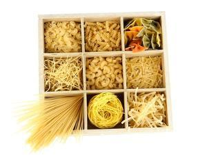 Nine Types Of Pasta In Wooden Box Sections Isolated On White by Yastremska
