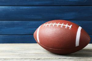Rugby Ball on Wooden Background by Yastremska