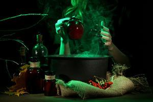 Witch in Scary Halloween Laboratory on Dark Color Background by Yastremska
