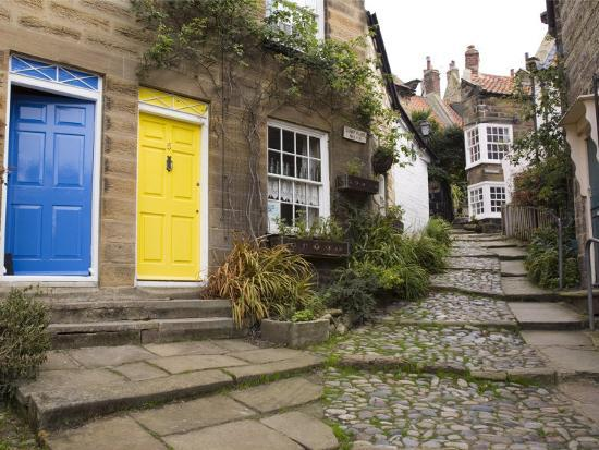 Yellow and Blue Doors on Houses in the Opening, Robin Hood's Bay, England-Pearl Bucknall-Photographic Print