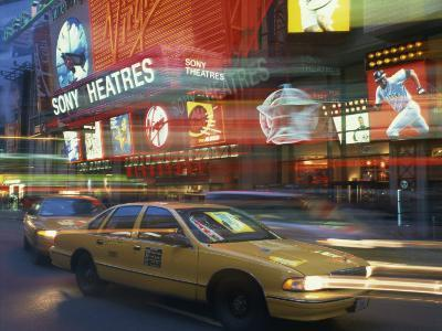 Yellow Cabs on the Street at Night, Times Square, New York, USA--Photographic Print