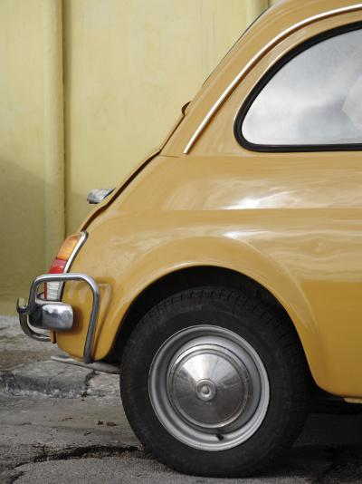 Yellow Fiat 500 Parked Against Wall, Gallipoli-David Borland-Photographic Print