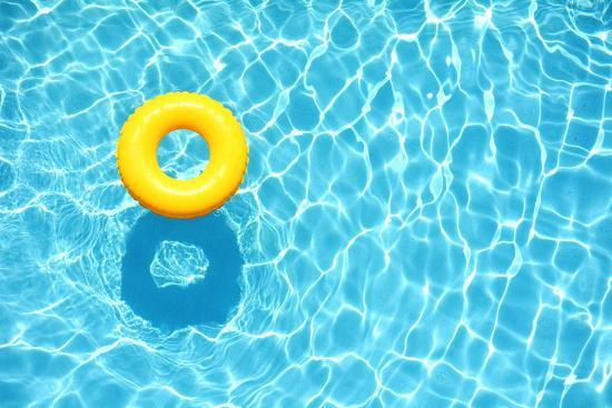 Yellow Pool Float, Ring Floating in a Refreshing Blue Swimming Pool ...