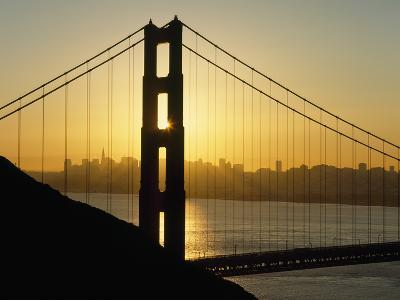 Yellow Sunrise Behind the Golden Gate Bridge with Skyline Behind-Design Pics Inc-Photographic Print
