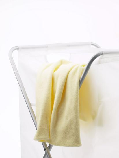 Yellow T-Shirt on Household Laundry Hamper--Photographic Print