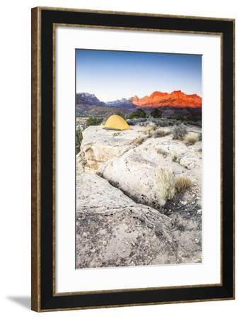 Yellow Tent And The Sun Setting On The Mountain Cliffs In The Background-Lindsay Daniels-Framed Photographic Print