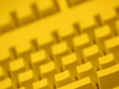 Yellow Tinted Computer Keyboard--Photographic Print