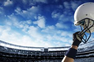 Football Player Raises His Helmet before an Important Game by yobro