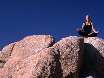 Yoga on the Rocks in the Joshua Tree National Park, California, USA-Cheyenne Rouse-Photographic Print