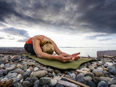 Yoga Position of Child's Pose in Lincoln Park - West Seattle, Washington-Dan Holz-Photographic Print