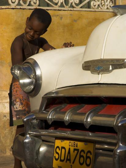 Young Boy Drumming on Old American Car's Bonnet,Trinidad, Sancti Spiritus Province, Cuba-Eitan Simanor-Photographic Print