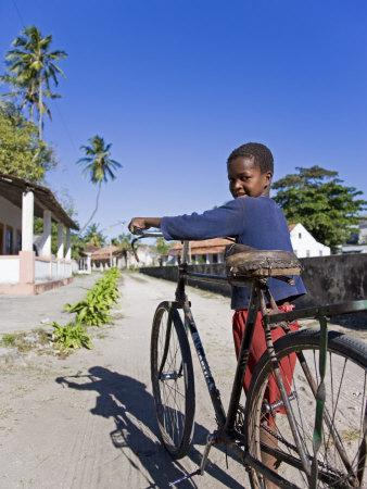 https://imgc.artprintimages.com/img/print/young-boy-on-ibo-island-part-of-the-quirimbas-archipelago-mozambique_u-l-p8yxlv0.jpg?p=0
