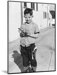 Young Boy Plays Cowboy in a California Alley, Ca. 1952