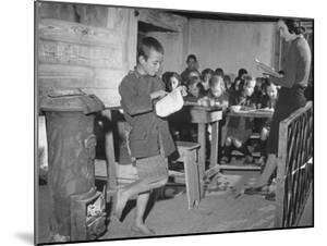 Young Boy Reading Allowed to the Class