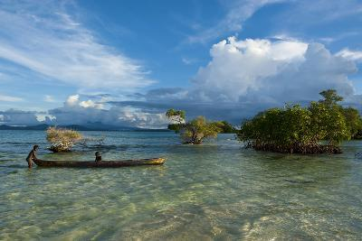 Young Boys Fishing in the Marovo Lagoon before Dramatic Clouds, Solomon Islands, South Pacific-Michael Runkel-Photographic Print